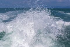 Blue ocean sea water wave with fast yacht boat wake foam of prop wash. Thailand. Close up Stock Photo