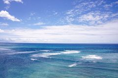 Blue ocean and blue sky with clouds Stock Photography