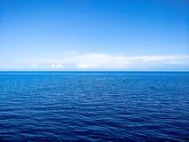 Ocean. Blue ocean and sky with clous on horizon royalty free stock photos