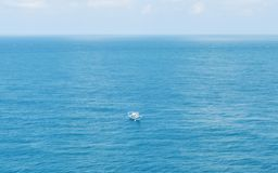 Blue ocean small boat Stock Images
