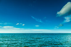 Blue ocean and sunny sky with clouds Stock Image