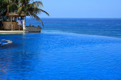 Blue Ocean With Swimming Pool of Luxury Hotel stock images
