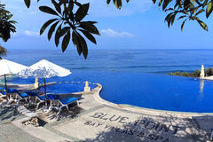 Blue Ocean With Swimming Pool of Luxury Hotel Royalty Free Stock Photography