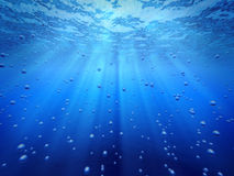 Blue ocean underwater. Blue ocean underwater light rays shining and gas bubbles Royalty Free Stock Image