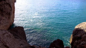 Blue ocean water at a bay stock video footage