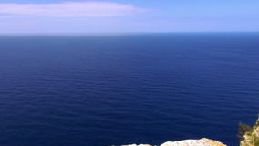 Blue ocean water and a cliff stock video footage
