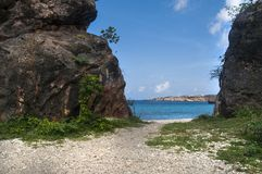 Blue ocean water and rocky beach. On Caribbean secluded island Royalty Free Stock Photos