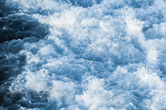 Blue ocean water with splashes and foam. Natural background photo texture Stock Photos