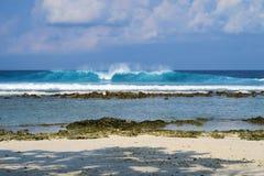 Blue ocean wave on beach of Maldives island Himmafushi. Jailbreaks spot Royalty Free Stock Images