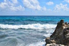 Blue ocean waves at rocky coast Royalty Free Stock Photo
