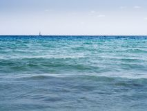Ocean scene with sailing ship on the horizon stock photo