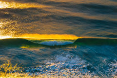 Blue Ocean Waves Under Yellow Sky during Sunset Stock Image