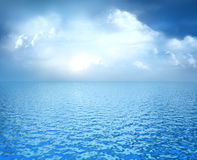 Blue ocean with white clouds on horizon. 3D concept vector illustration