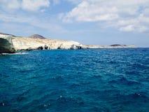 Blue ocean. White stone shores on the ocean Stock Photo