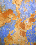 Blue and ocher grunge wall closeup Stock Photography