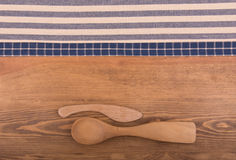 Blue and off white kitchen towels on dark wood background Stock Photo