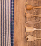 Blue and off white kitchen towels on dark wood background Royalty Free Stock Images