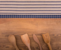 Blue and off white kitchen towels on dark wood Royalty Free Stock Photos