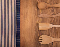 Blue and off white kitchen towels on dark wood Stock Photo
