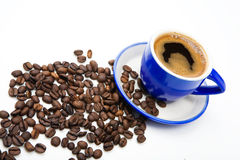 Blue offee cup and beans Stock Images