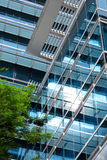 Blue office building. Modern office building with blue glass windows facade Stock Photo