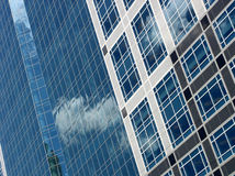 Blue office building. High quality abstract image of blue office building with clouds reflecting in the glass Royalty Free Stock Photography