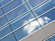 Blue office building. High quality abstract image of blue office building with clouds reflecting in the glass Royalty Free Stock Image