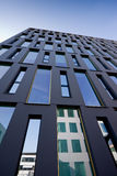 Blue office building. With high narrow windows Royalty Free Stock Images