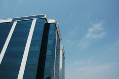 Blue Office Building. Office building in blue tones with sky background royalty free stock images