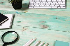 Office table desk with set of colorful supplies. Blue office desk table with with office supplies. Top view with copy space Stock Images
