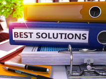 Blue Office Folder with Inscription Best Solutions Stock Photos