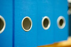 Free Blue Office Folders With Round Metal Rings At The End Of The Folder Stock Photo - 152987910