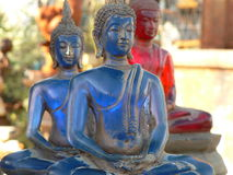 Blue Old Buddhist statue. Blue and Red Royalty Free Stock Photography