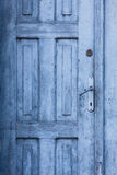 Blue old closed door. Fragment of blue old closed door Royalty Free Stock Images