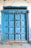 Blue old closed  door to the house on the island of Zanzibar Royalty Free Stock Images