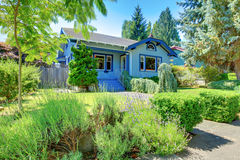 Blue old cute craftsman style home. Royalty Free Stock Photo