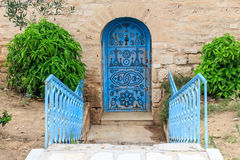 Blue old doors symbol of Tunisia. Old blue old door in oriental style Tunisia Royalty Free Stock Image