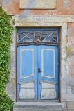 Blue old fashioned wooden door on colored facade. Tallinn. Royalty Free Stock Images