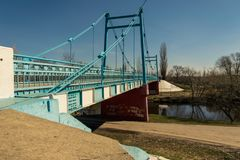 A blue, old foot bridge across the river in Tambov. Royalty Free Stock Photography