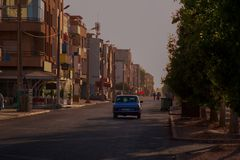 Blue old grand taxi Mercedes at sunset in Agadir Morocco royalty free stock image