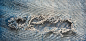 Blue old ripped jeans closeup Royalty Free Stock Images