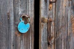 Free Blue Old Rusty Unlocked Padlock On Wooden Door Stock Photo - 157581390