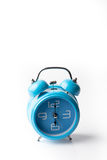 Blue old style alarm clock on white background Stock Image