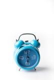 Blue old style alarm clock on white background Stock Image
