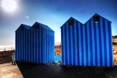 Blue Old Style Beach Huts Stock Photography