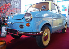 Blue old-timer NSU Prinz. BUDAPEST - APRIL 16: Blue, renovated NSU Prinz II, 1961 on red stage on 4th Oldtimer Expo on April 16, 2010 in Budapest, Hungary Royalty Free Stock Photo