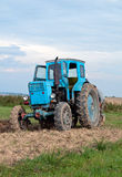 Blue old tractor Stock Photos