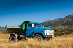 Blue old truck. On background of mountains Royalty Free Stock Photo