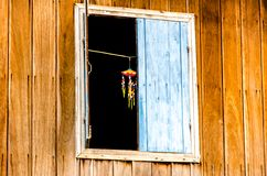 Blue old window in wooden house Stock Photography
