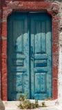Blue old wooden doors in Oia Santorini Greece Stock Photo